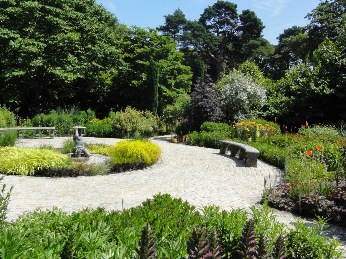 Courtyard GardenA formal garden with a centre piece statue surrounded by colour